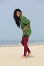 African american girl walking at the beach Royalty Free Stock Photo
