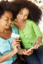 African american girls with phone and credit card Royalty Free Stock Photo