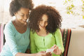 African american girls with phone Royalty Free Stock Photo