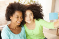 African american girls taking a self portrait Royalty Free Stock Photo