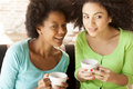 African american girls talking and drinking coffee Royalty Free Stock Photo