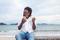 African american guy with dreadlocks and white shirt receiving good news Royalty Free Stock Photo