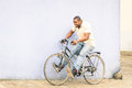 African american guy having fun with vintage bicycle - Free time Royalty Free Stock Photo