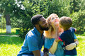 African American happy family: black father, mom and baby boy on nature. Use it for a child, parenting Royalty Free Stock Photo