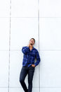 African american male fashion model smiling with blue shirt Royalty Free Stock Photo