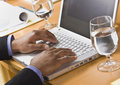 African American male hands on laptop. Royalty Free Stock Photo