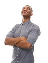 African american man laughing with arms crossed portrait of a young Stock Images