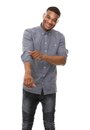 African american man smiling and rolling up sleeves portrait of a Stock Images
