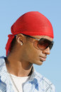African american man young smiling with red headscarf on and wearing sunglasses Royalty Free Stock Photography