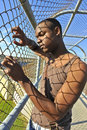 African American model behind a fence. Royalty Free Stock Photos