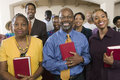 African american people with bibles in church portrait of smiling standing the Stock Photos