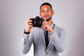 African american photographer holding a dslr camera black peop over gray background people Royalty Free Stock Photography