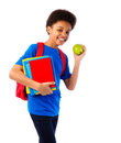 African american school boy with books happy teenager colorful bag and apple education and concept isolated over Royalty Free Stock Photos