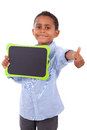African american school boy holding a blank black board black isolated on white background people Stock Photos