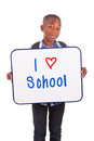 African american school boy holding a blank board black people isolated on white background Royalty Free Stock Photography