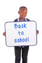 African american school boy holding a blank board black people isolated on white background Royalty Free Stock Images