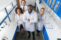 African American Scientist With Group Of Researchers In Modern Laboratory Happy Smiling, Mix Race Team Of Scientific Royalty Free Stock Photo
