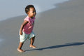 African American toddler running on the beach Royalty Free Stock Photo