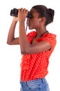 African American using binoculars isolated over white background Stock Photo