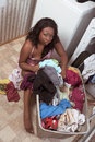 African American woman by basket of dirty laundry Stock Photography