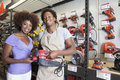 African american woman buying tool at hardware store women Stock Photos