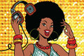 African American woman DJ with headphones Royalty Free Stock Photo