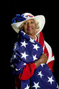 African-American woman draped in an American flag. Royalty Free Stock Image