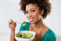 African American Woman Eating Salad Royalty Free Stock Photo