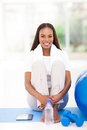 African american woman exercise pretty sitting on mat at home Stock Images