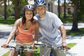 African American Woman & Man Couple Riding Bikes Stock Image