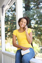African American Woman on Porch Royalty Free Stock Photography