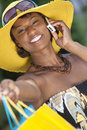 African American Woman, Shopping Bags & Cell Phone Stock Image