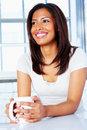 African American woman sitting with a coffee mug Royalty Free Stock Photography