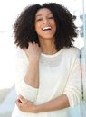 African american woman smiling outdoors close up portrait of a cheerful young Stock Image