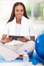 African american woman tablet pretty holding computer after workout Stock Photography