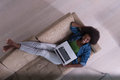 African American woman using laptop on sofa top view Royalty Free Stock Photo