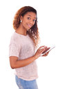 African american woman using a tactile tablet isolated on white background Stock Image