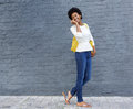 African american woman walking and talking on cellphone Royalty Free Stock Photo