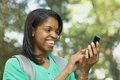 African American young woman on smart phone Stock Image