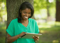 African American young woman on tablet computer Royalty Free Stock Photo