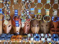African animal masks and masai jewelry a display of souvenirs including wooden beaded bracelets necklaces Stock Images