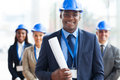 African architect team handsome male holding blue print and Stock Photo