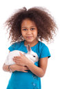 African Asian girl holding a rabbit Stock Photography