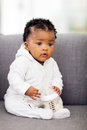 African baby milk bottle cute on a sofa with a Royalty Free Stock Photos