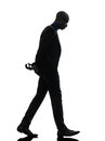 African black man walking looking down silhouette one in studio on white background Stock Photography