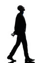 African black man walking looking up smiling silhouette one in studio on white background Stock Images