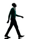 African black man walking looking up smiling silhouette silhouet one in studio on white background Stock Photo