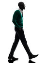 African black man walking silhouette one in studio on white background Royalty Free Stock Photos