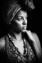 African black young woman beauty portrait with turban studio bw Royalty Free Stock Photo