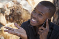 African boy on cell phone Royalty Free Stock Photo